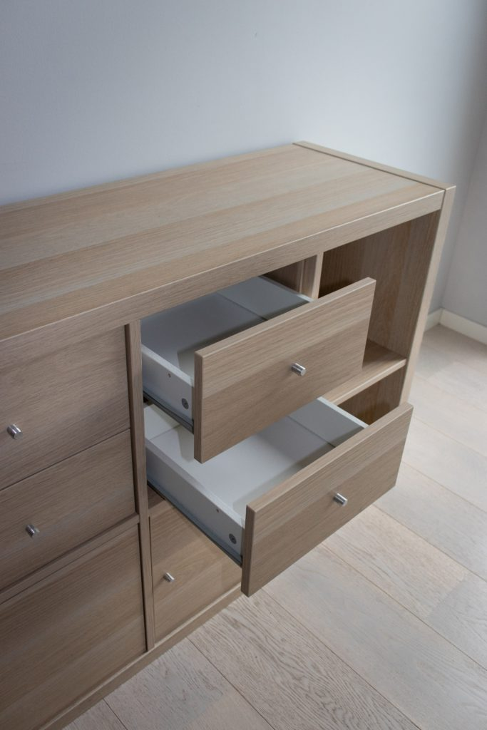 a wooden filing cabinet